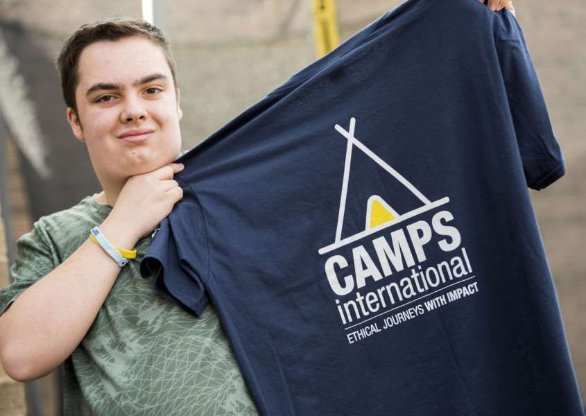 Joshua Williams with his Camp International shirt which businesses can have their logo on. Picture Mark Westley
