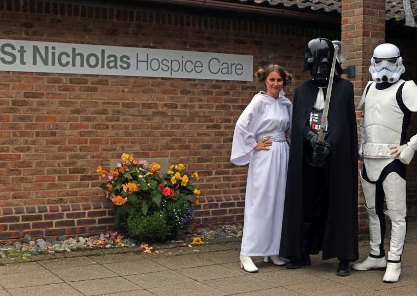 Princess Leia, Darth Vader and a Stormtrooper prepare for St Nicholas Hospice Care's 'Star Wars Day' in Bury St Edmunds on Saturday ANL-151214-155601001