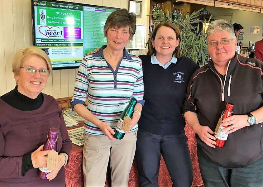 VICTORIOUS: Bury GC Ladies Three Clubs and a Putter winning team (from left) Yvonne Horne, Molly Smith, ladies' captain Hannah Clark (presenting) and Tracey Claydon