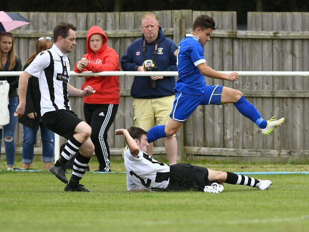 SLIDING IN: Melford's Sam Bayliss goes to ground to halt Ed Nobb's progress during Saturday's 0-0 draw with Brantham Picture: Mark Bullimore
