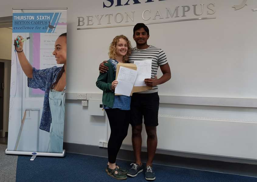Vinu Ariyaratne and Scarlett Jarrald, from Thurston Sixth Form, picked up their A-Level results having got engaged in July ANL-160818-120340001