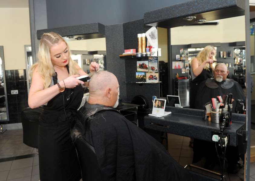 Henry Mayhew from Sudbury Town Council, is once again shaving his head and beard for charity, this time Kids with Cancer.''Pictured: Henry with Junior Stylist Kelsey Perry''PICTURE: Mecha Morton