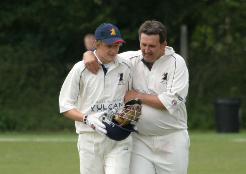 SECOND-EVER APPEARANCE: A young Luke Youngs is congratulated by dad and vice-captain Simon Youngs during Luke's second match as Haverhill wicketkeeper