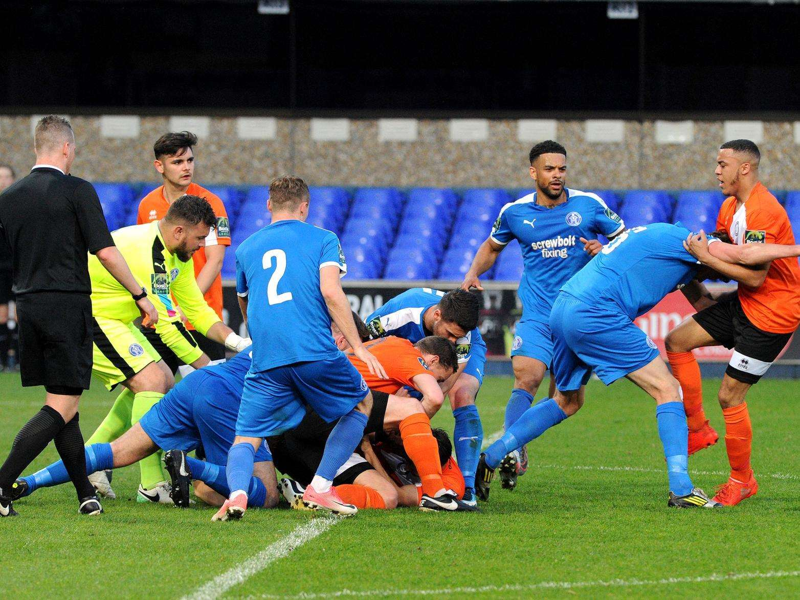 Bury Town captain Ollie Fenn was sent off from this melee Picture: Mecha Morton