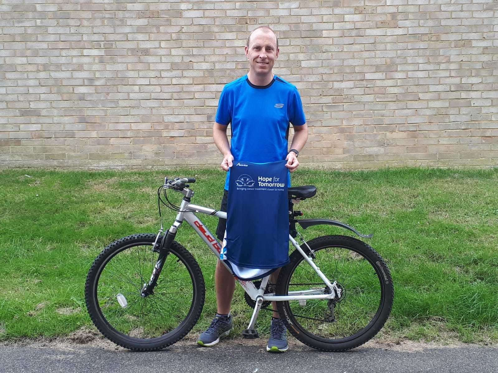 Mark Crouch with his bike and the vest he will be wearing while completing his charity challenge for Hope for Tomorrow. Contributed photo