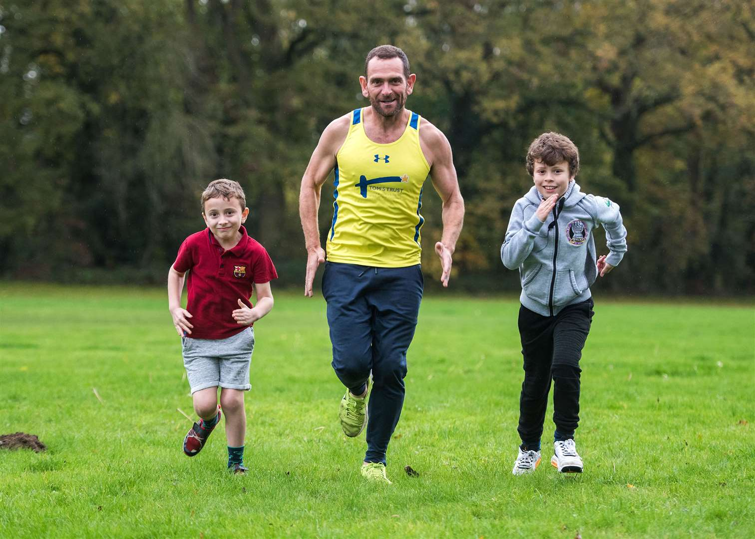 Ben Blowes limbers up for his 31 marathons challenge with his sons Spencer, eight, and Joel, 10. Picture: Mark Westley