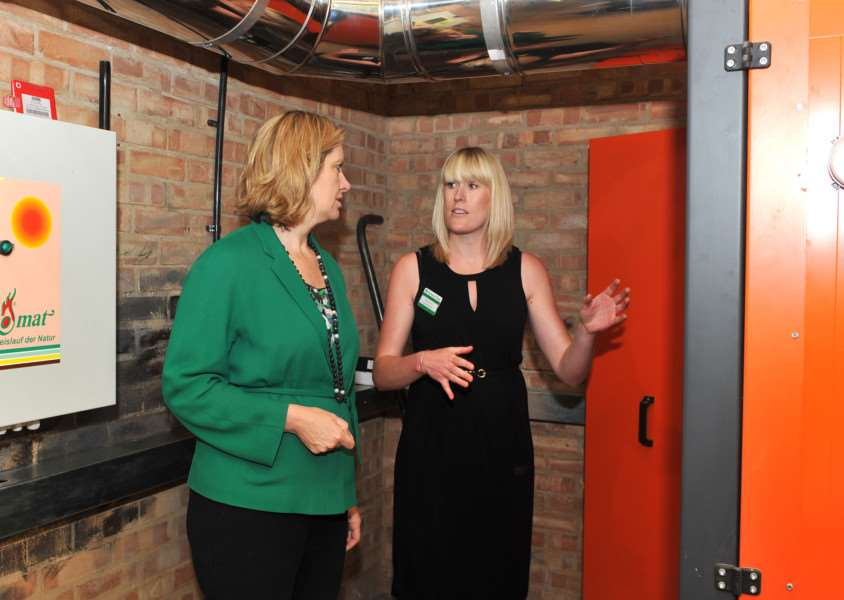 MP Amber Rudd takes a tour of Ickworth's biomass boiler room with project manager Stephanie Hall