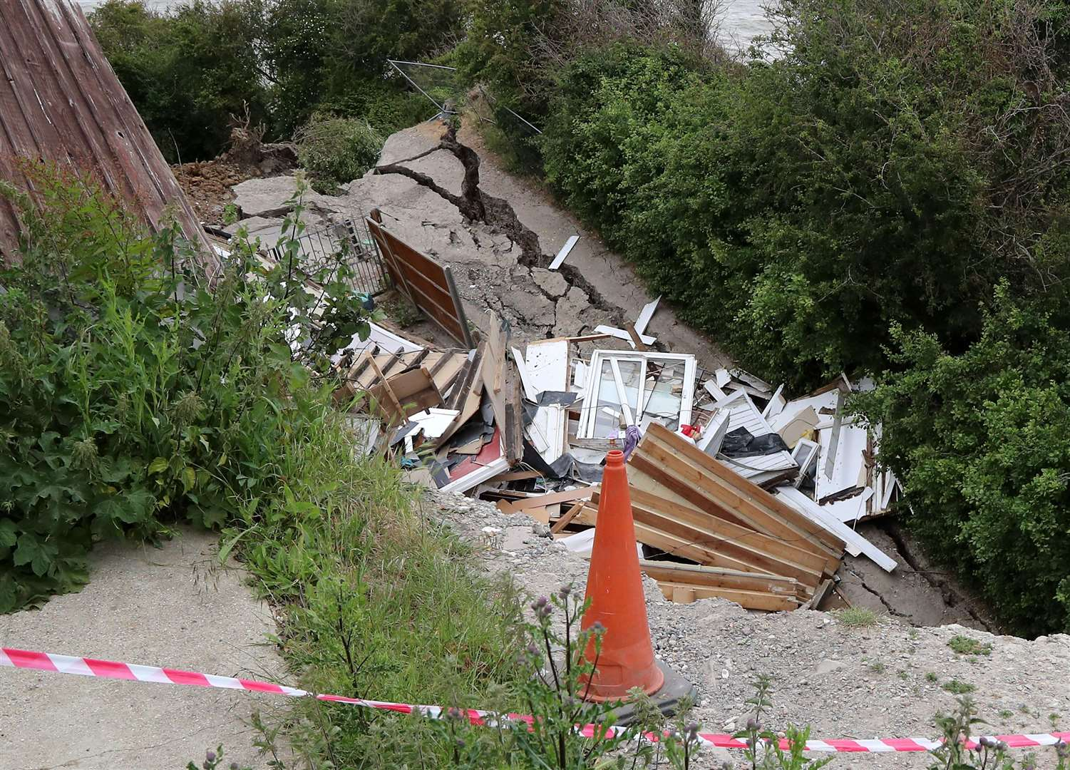 A landslip caused a bungalow to collapse towards the sea in an incident last year (Gareth Fuller/PA)