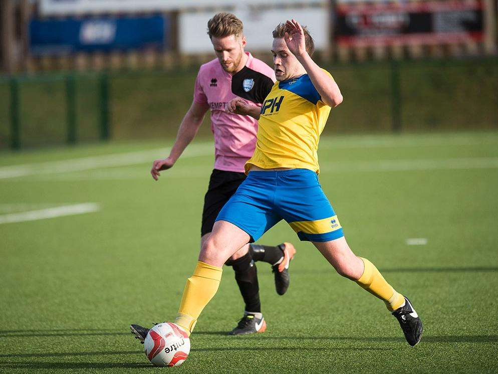 FIGHTING HARD: Shaun Avis for Newmarket Town (Picture: Mark Westley)