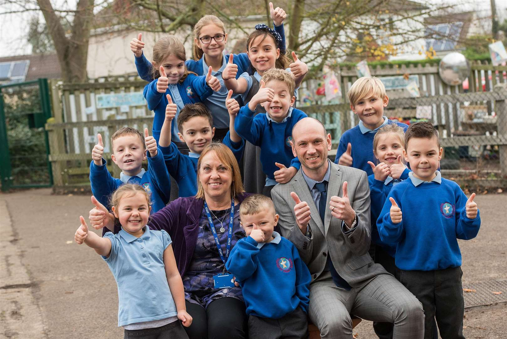 Thurston Primary School, have just been given a 'good' rating from Ofsted. Kathy Lambert and John Bayes the headteachers with pupils. Picture: Mark Westley.