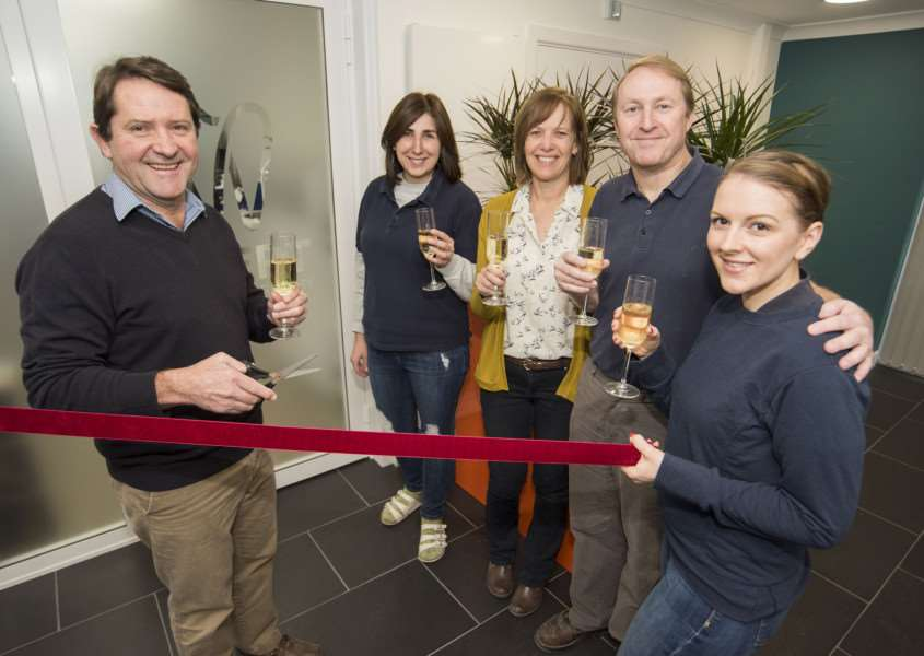 Marthinus Robbertse and his staff celebrate the re-opening of the dental laboratory