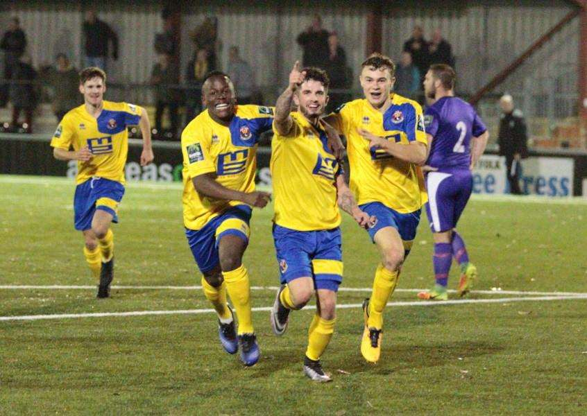 GOAL-DEN MOMENT: Jake Clowsley (centre) celebrates his winner. Picture: Clive Pearson
