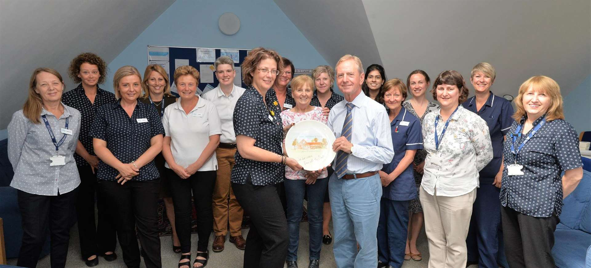 Colleagues at Newmarket's Orchard House surgery present Dr Bailey with a hand painted plate to mark his retirement