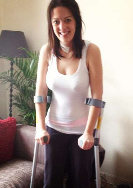 michelle parry feature - michelle on crutches after one of her operations ANL-160525-205308001