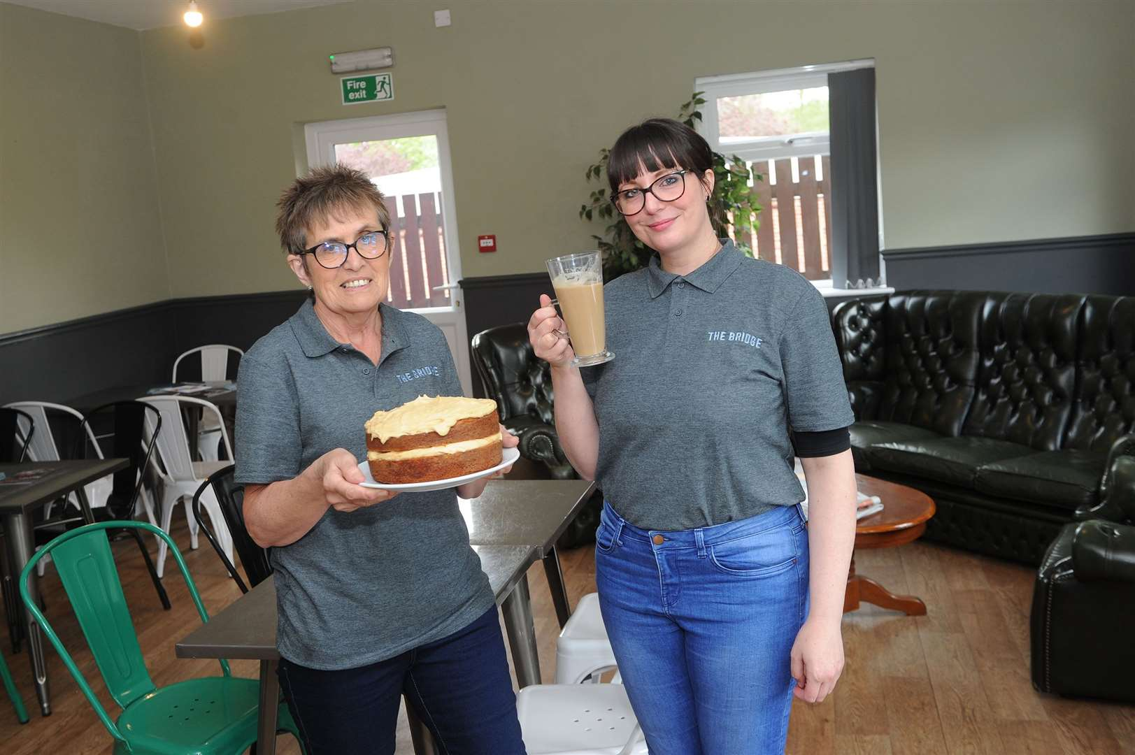 The Bridge Project was hit with an online scam in January losing £10K and said it could not expand its successful meal delivery service as a result. The owner of Brundon Lane cafe has come forward to offer the charity to run the cafe on the business park, which will mean that if it works out, they can expand their meal service. ..Pictured: Cyndi Gosling (Cafe Manager) and Josie Hague (Team Member)..PICTURE: Mecha Morton... (9830227)