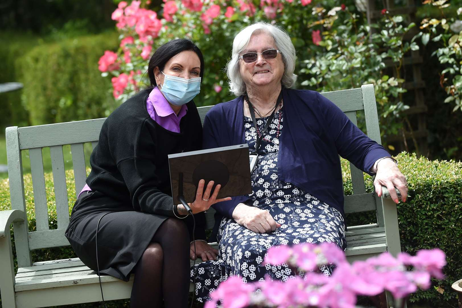 St Josephs Care Home in Sudbury has been taking part on a government backed pilot scheme to help residents keep in touch with their loved ones during the lockdown..Pictured: Deputy Manager Jacqui Court and resident Marie Gould on the portal device....PICTURE: Mecha Morton .... (36322432)