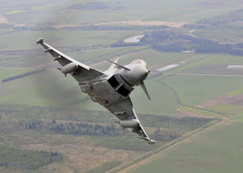 A Royal Air Force Typhoon FGR4 in flight [MoD picture by Cpl Neil Bryden ]
