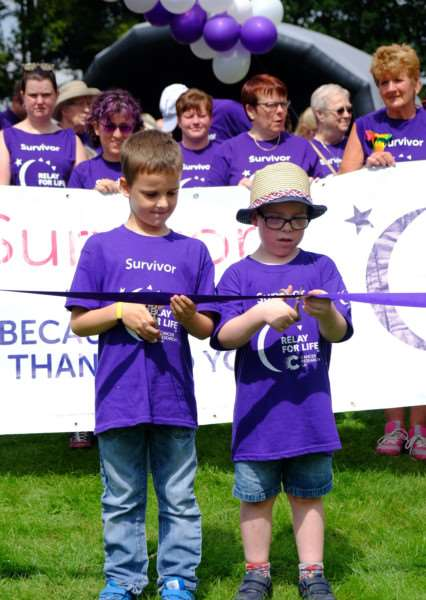 Kodie Pollak and Henry Dalgoutte officially start the Cancer Research UK Relay for Life at Nowton Park.'Pic - richard Marsham/RMG Photography