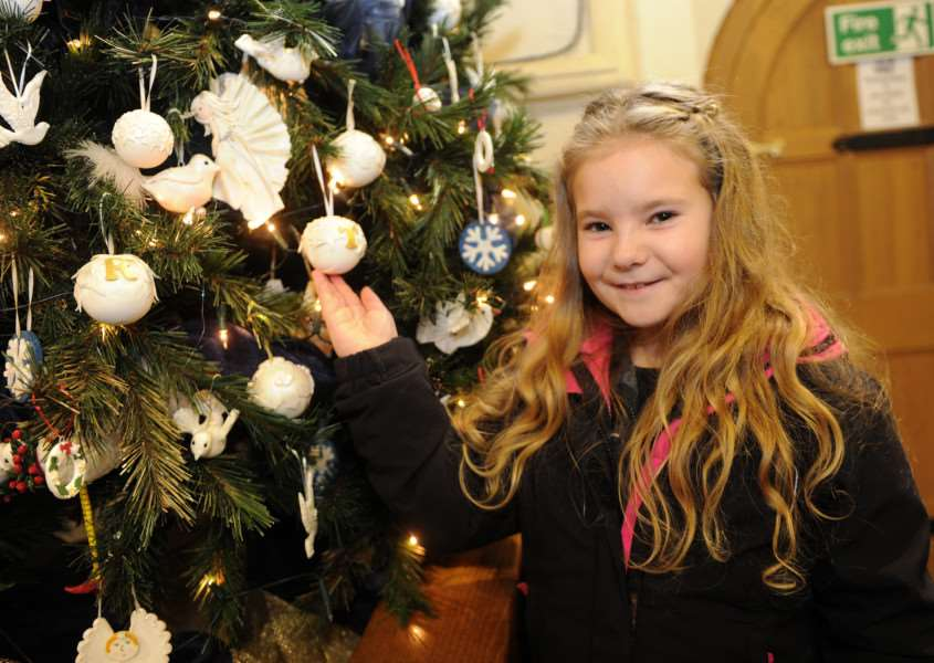 Christmas Tree festival at St Peter and St Marys Church Stowmarket''Pictured; Lily Cunningham visiting the displays ANL-161128-081158009