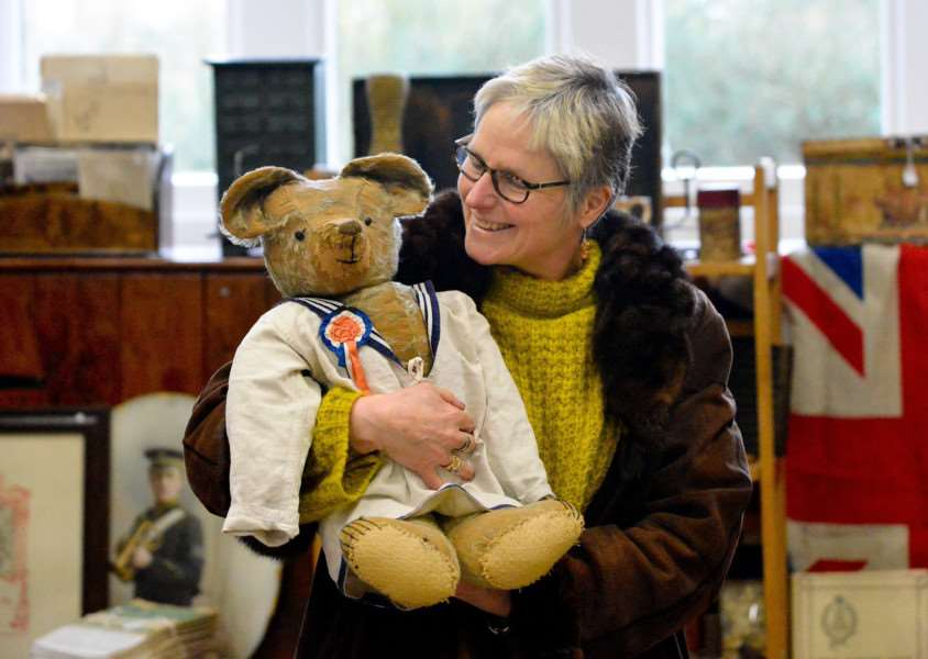 "Antiques and Vintage Fair at The Old School Community Centre in Long Melford. Anna Kayser with her new Victorian bear ""Jonathan""."