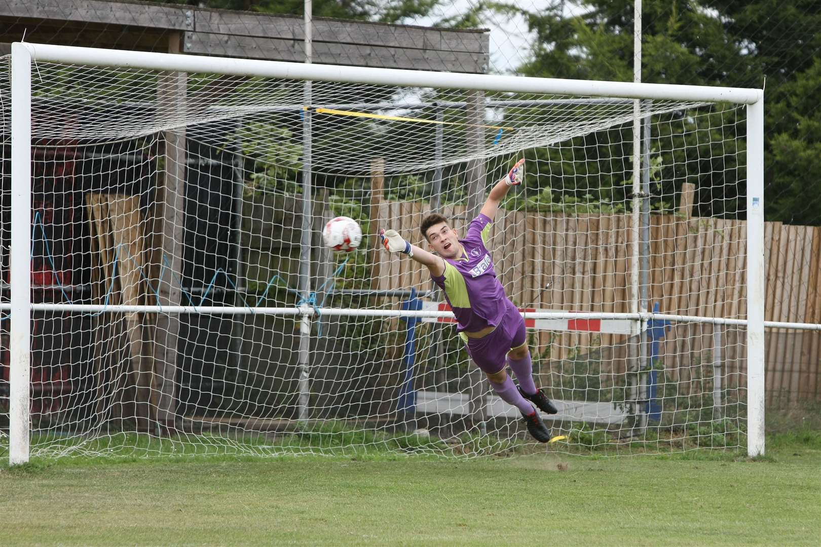 Long Melford FC v Woodbridge Town. Woodbridge keeper, Alfie Stronge makes a flying save from a Melford free kick.. (14712764)