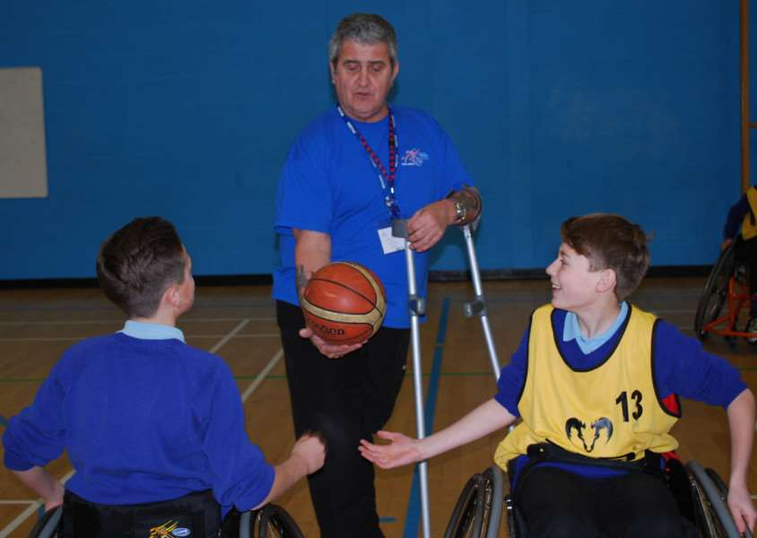 Students at Linton Village College trying wheelchair basketball ANL-160126-100110001