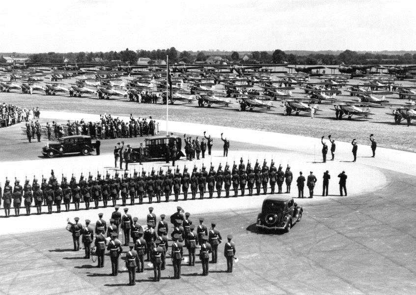 The Guard of Honour salutes King George V on his arrival at Mildenhall on 6 July 1935 for the Silver Jubilee Review of the Royal Air Force.