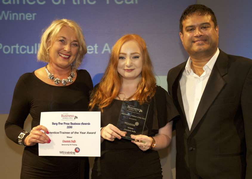 Jane Wood of WS Training hands the 2016 award to Chantele Roffe of Bury's Portcullis Market Access, watched by compare Paul SInha. ''Picture: MARK BULLIMORE