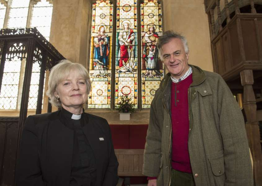 The Rev Lynda Sebbage at'St Peter's and St Paul's Church, Clare by the Three Virtues stained glass window. The church has launched a �50,000 appeal because the stonework around the window needs to be fixed, pictured with church warden Bill Perceval-Maxwell.'Picture Mark Westley