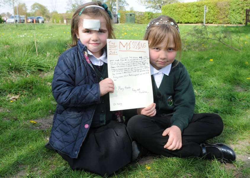 Florence Follen with her sister Ruby holding the letter appealing for the return of their pet pygmy goat Judy PICTURE: Mecha Morton