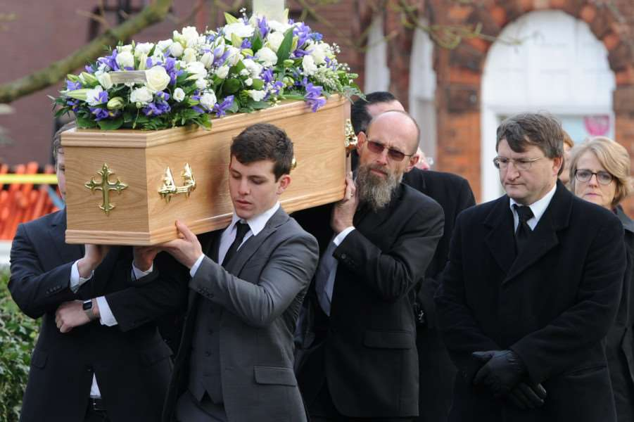 Pallbearers carry Tim Marks' coffin into St Mary's Church in Haverhill