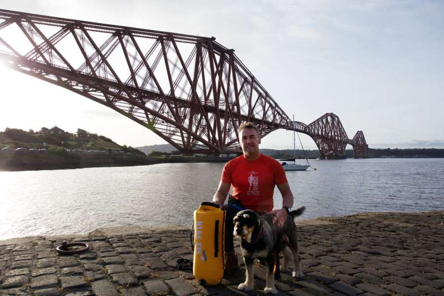 HOME WATERS: Iain Johnston with dog Sparky prior to his Firth of Forth Swim