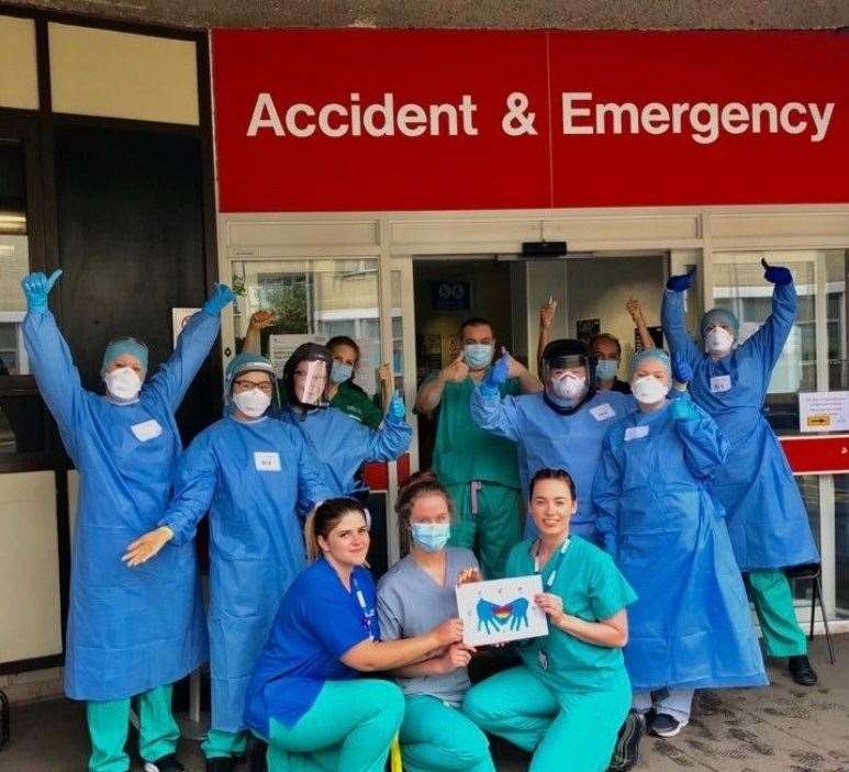 Staff at Addenbrooke's Hospital A&E Department with Emilia Hutton's drawing. contributed