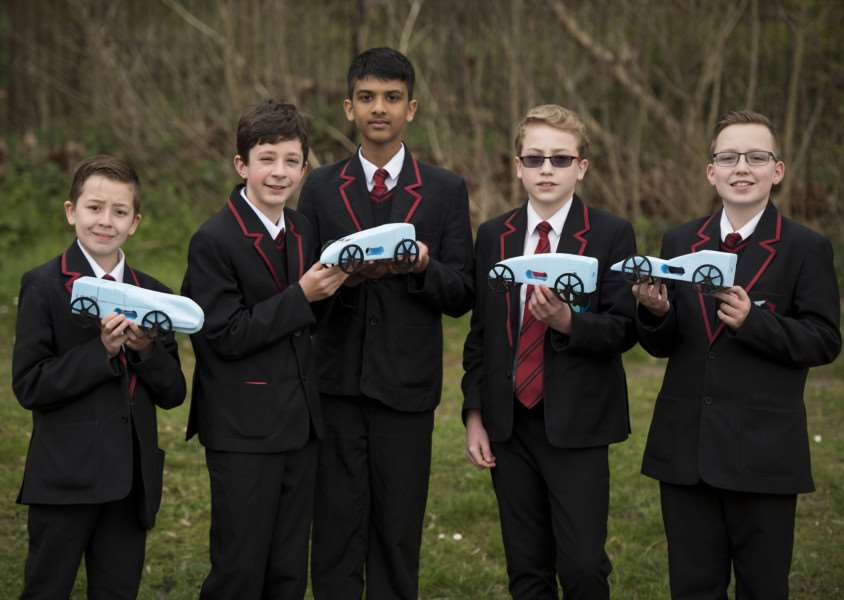 Competitors Noah Kline, Benn Hobbs, Andrew Varghees, Reece Bright and Joshua Dove with their rocket cars
