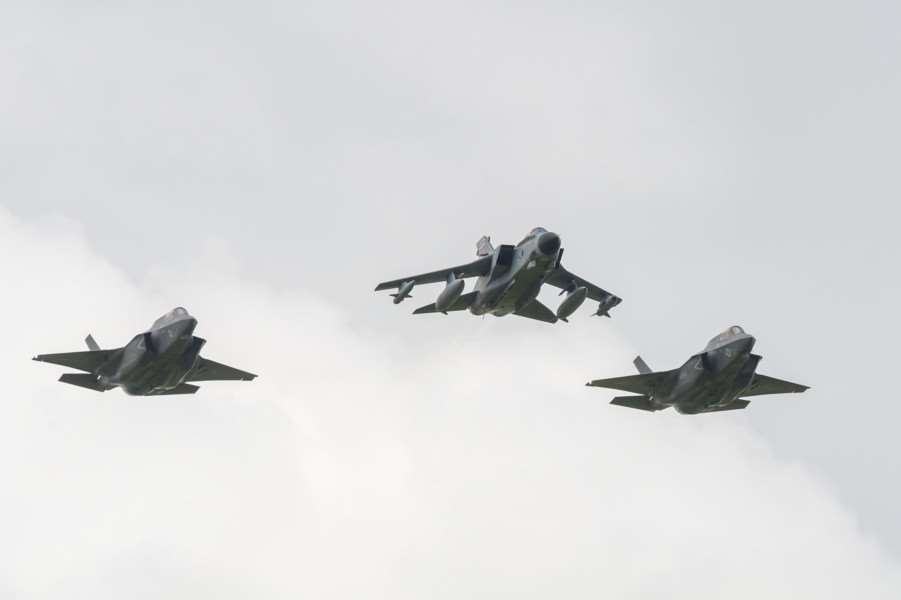 A Tornado GR4A leads Two F-35B Lightning aircraft over their future home at RAF Marham ANL-160207-000945009