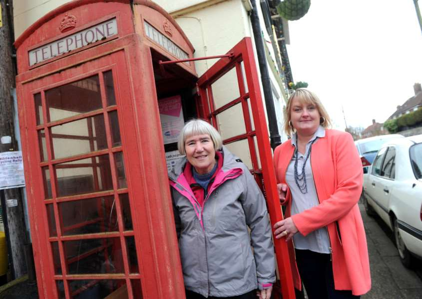 Barton Mills Parish Council's chairman Pamela Boura and clerk Abigail Davies at the red phonebox the council wants to use for a defibrillator ANL-160803-084247009