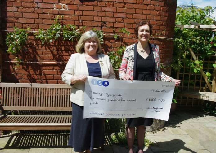 Sue Angland handing over a cheque to Helen Organ in support of Sue Ryder's Synergy Caf�s. ANL-150619-165900001