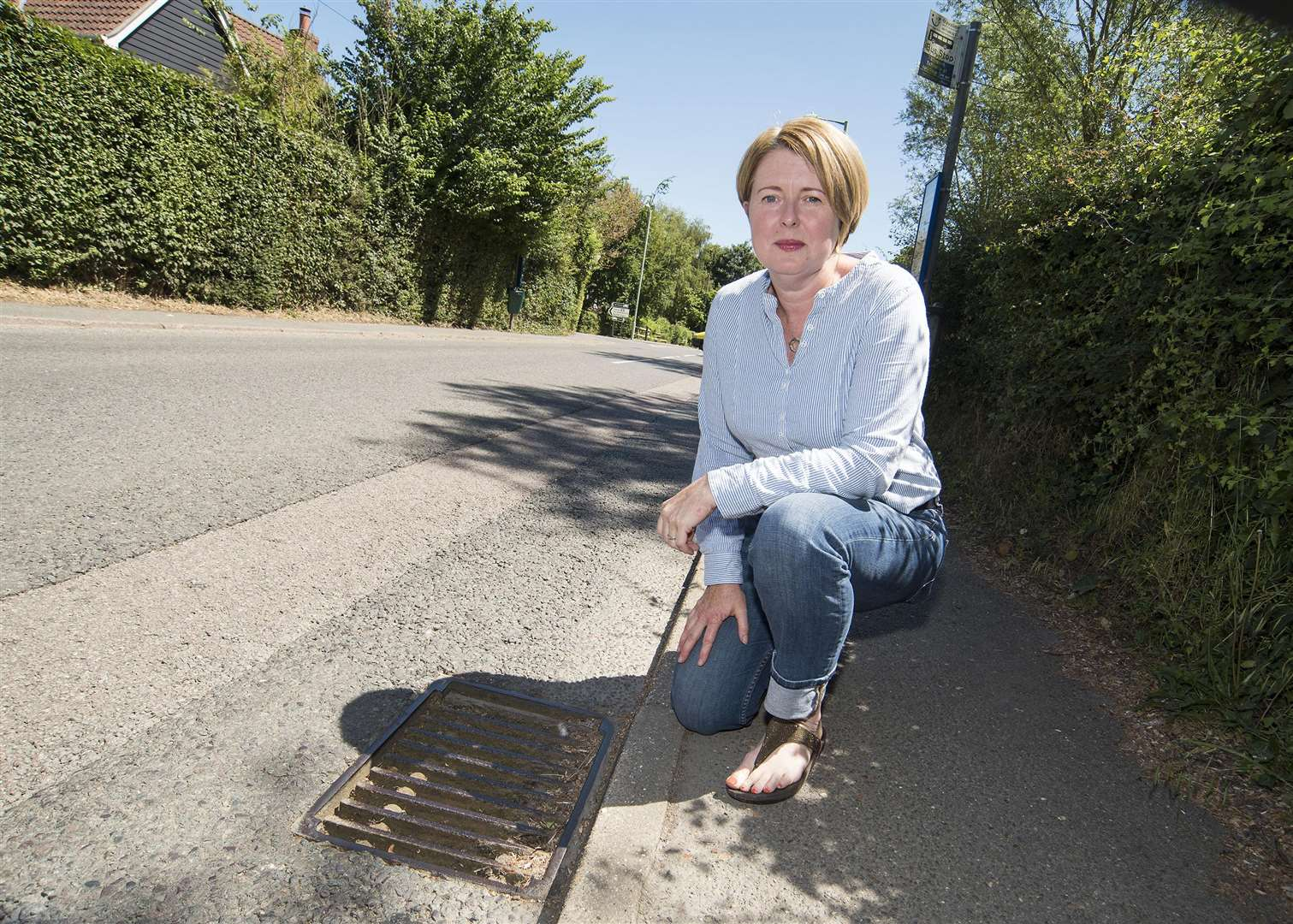 School Road, Elmswell.Clare Norgate has complained many times over the last 15 months to the council about a blocked drain which is causing people to be soaked as they walk past or wait for a bus. .Picture Mark Westley. (2747581)