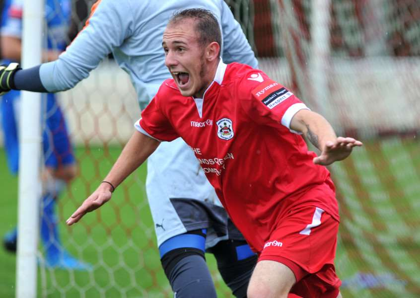 TRANSFER LISTED: Adam Mills in action for Needham Market against Leiston earlier this season. He scored two goals in that fixture in August but is not set to feature in the reverse fixture on Boxing Day Pictured: Adam Mills celebrates scoring Needhams first goal ANL-150831-184739009