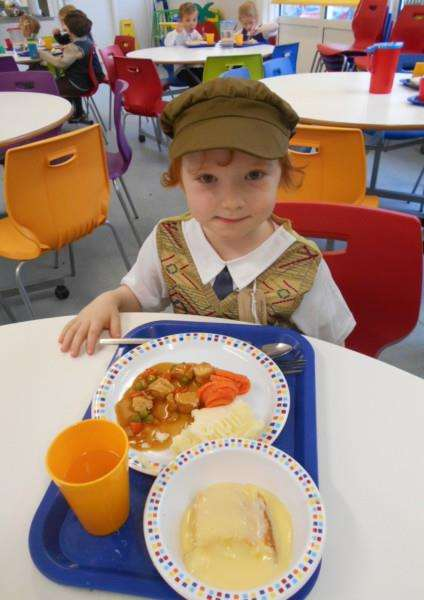 Kai Skinner of Cherry Class enjoying a Second World War lunch at Pot Kiln Primary School.