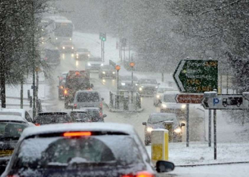 Traffic in the snow in Rougham Road, Bury St Edmunds. Picture: Robert Robertson