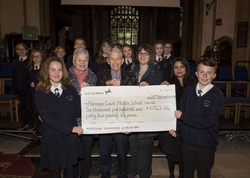 Headboy Matt Jones, 13 and headgirl Abi Longhurst, 13, with a cheque for all money raised for local charities