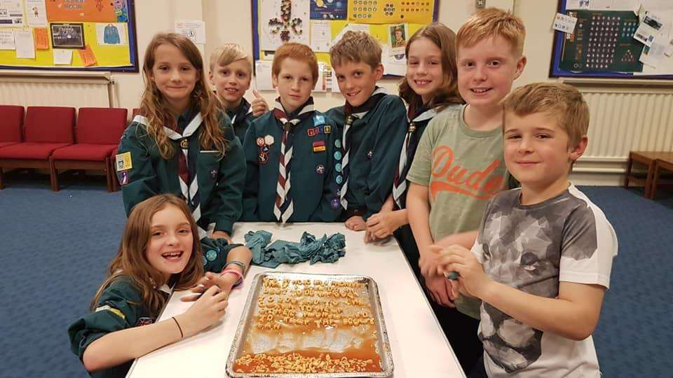 1st Honington (RAF) Merlin Scout troop spell out the Scout promise using spaghetti shapes.