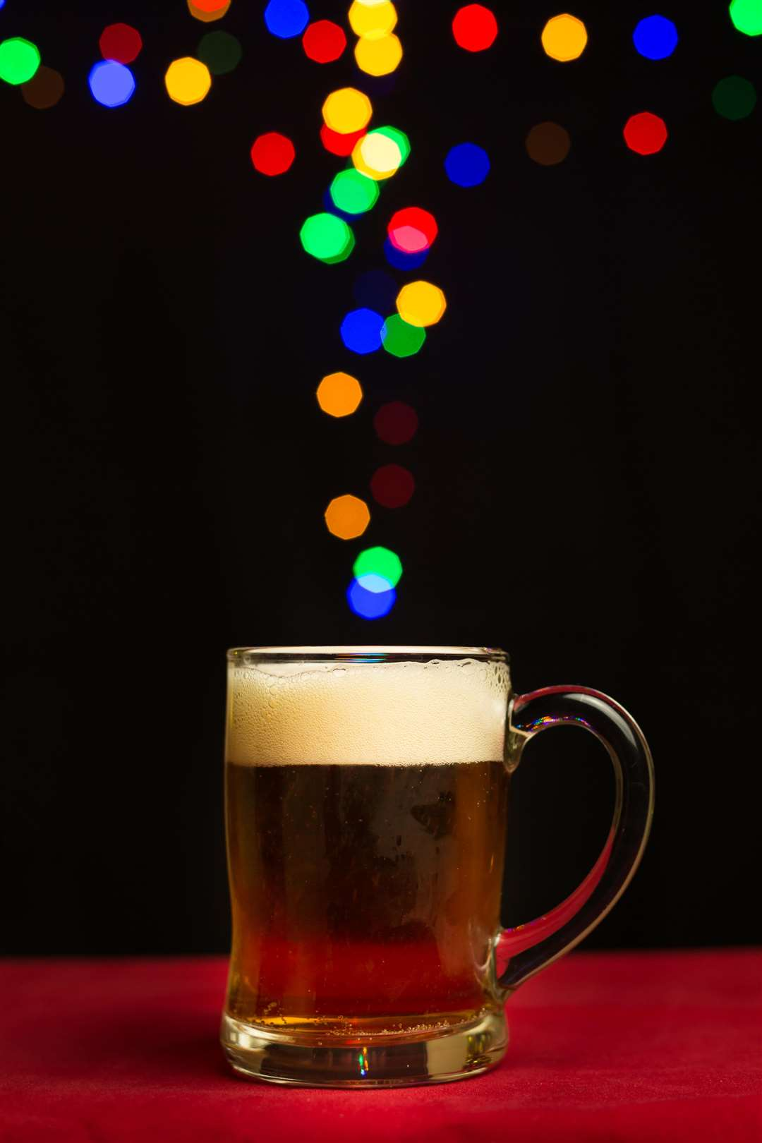 colorful bokeh lights floating out of a beer glass (5577142)