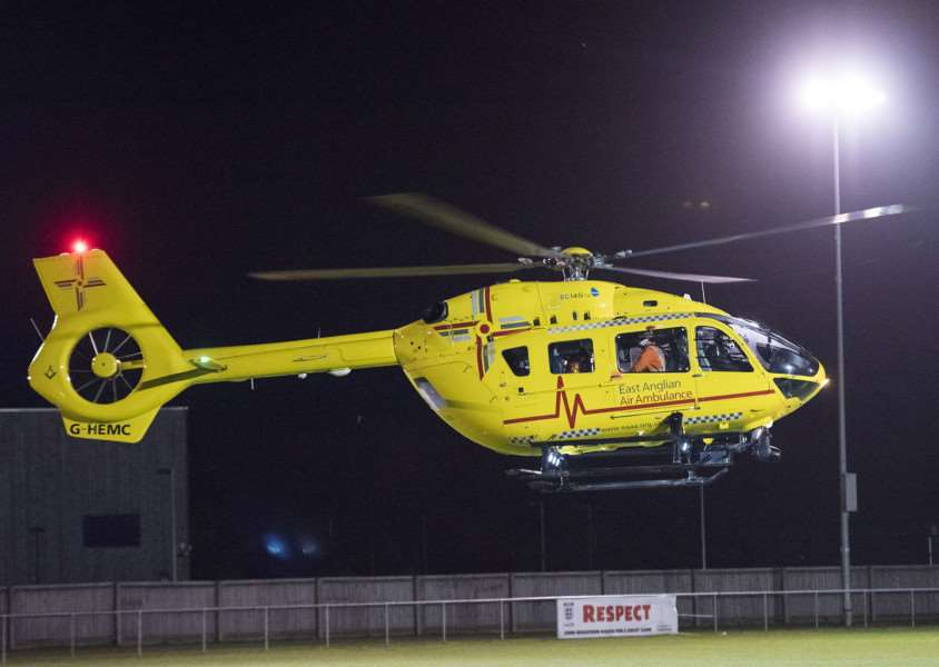 EMERGENCY: The air ambulance takes off from the grass pitch at The New Croft on Friday (Picture: Mark Westley)