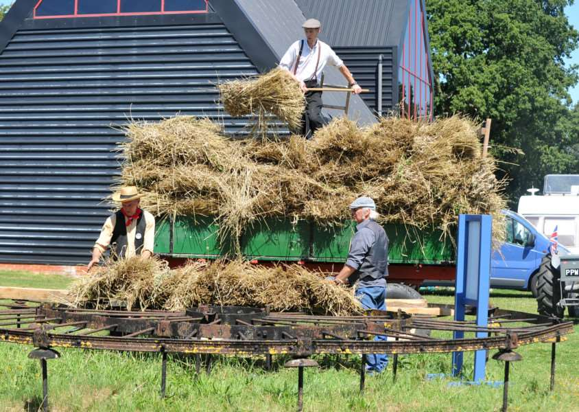 A team starts building a hay rick on the Garret frame, which was made in Leiston
