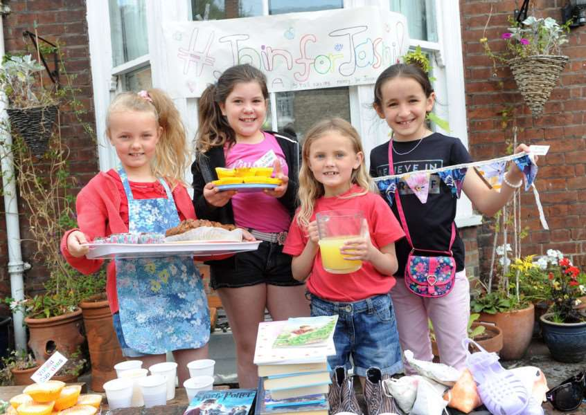 A group of friends set up a stall to raise funds for a charity to support their friend Jasmi Hazy-Blue Lindberg Cooke Pictured: Emily Eccles (9), Mia Turner (9), Lou Lou Eccles (7) and Finola Thacker (9) PICTURE: Mecha Morton
