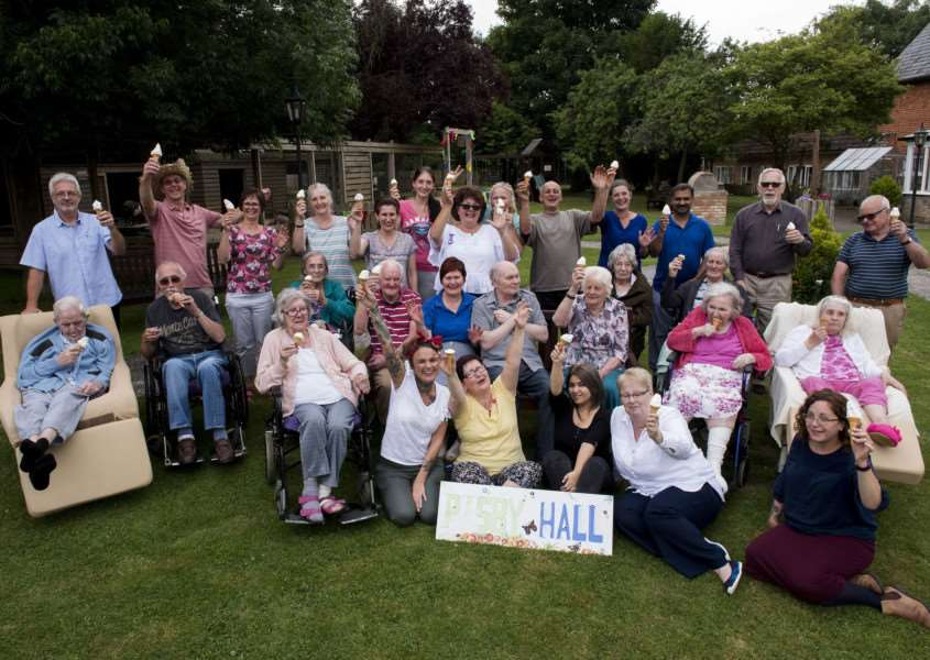 Staff and residents at Risby Hall Nursing Home celebrate their 'outstanding' rating from the CQC