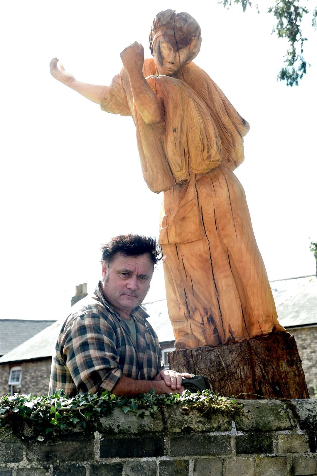 A project, which pays homage to Sudbury's silk weaving industry, is nearing completion..A statue in Weavers' Piece garden, carved out of a tree is a new edition to the site...Pictured:John Moore (carpenter)....PICTURE: Mecha Morton ... (16092492)
