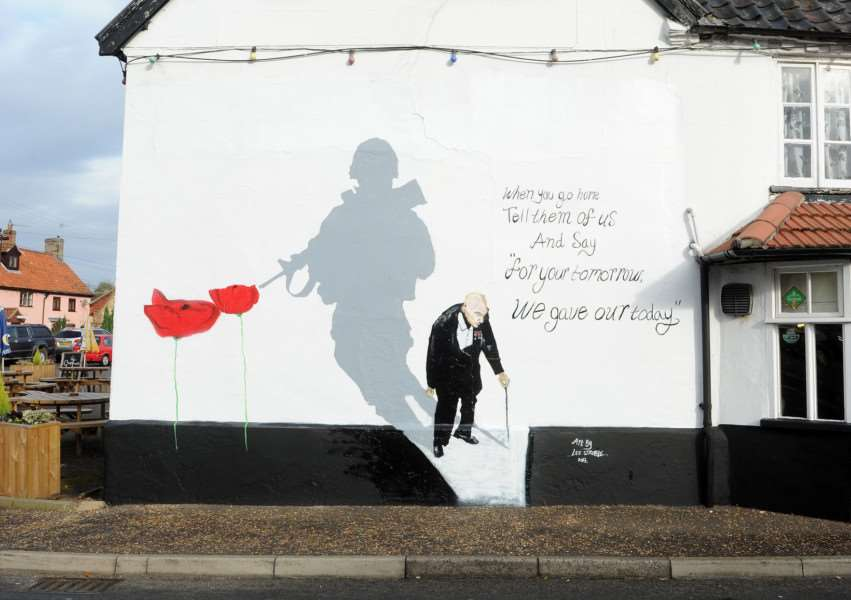 The black Horse pub in Thetford has a new Remembrance Day mural on its wall''''''PICTURE: Mecha Morton